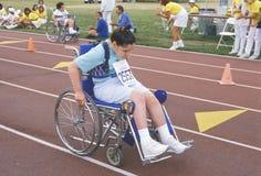 Athlète de Jeux Olympiques spéciaux dans le fauteuil roulant, concurrençant, UCLA, CA Photographie stock libre de droits