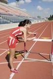 Athlète féminin Stretching Leg Photographie stock
