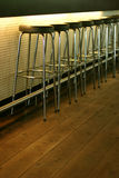 Athmospheric bar. Empty row of stools at a bar Stock Photo