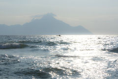 Athos 2. Sparkling wild sea on a sunny day with mount Athos in the background Stock Image