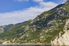 Athos Peninsula seaside in Autumn,and Cloisters perched in Hillsides. stock image