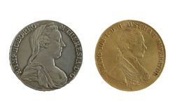 Atique Austria empire coins. Ancient Austria empire coins, silver - with empress Maria Theresia, gold - with emperor Franc Iosif Royalty Free Stock Photos