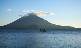 Atitlan Lake, Guatemala. Boat in distance and view of volcanoes in Atitlan Lake, located in Guatemala Royalty Free Stock Photos