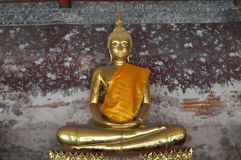 A atitude de conter Mara Buddha foto de stock