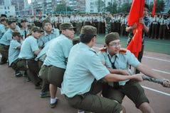 Atividade de treino militar 15 das estudantes universitário de China Fotografia de Stock