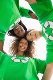 Ativistas ambientais que abraçam e que olham para baixo na câmera Imagem de Stock Royalty Free