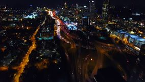 Atlanta Aerial Flying over freeway, interchanges. Cityscape views on night downtown stock footage