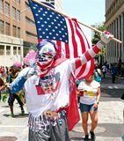 Atlanta Carnival American Flag Guy. A man wearing an outfit featuring the American Flag during a parade for Atlanta Caribbean Carnival 2014 Stock Photography