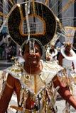 Atlanta Carnival Black and Silver Headdress Man. A man wearing a black, silver, and gold outfit during a parade for Atlanta Caribbean Carnival 2014 Stock Photo