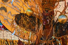 Atlanta Carnival Black and Silver Headdress Woman 4. A woman wearing a black, silver, and gold outfit during a parade for Atlanta Caribbean Carnival 2014 Stock Photo