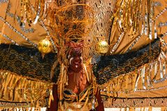 Atlanta Carnival Black and Silver Headdress Woman 3. A womanman wearing a black, silver, and gold outfit during a parade for Atlanta Caribbean Carnival 2014 Stock Photo