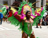 Atlanta Carnival Green Feathers Outfit. A woman wearing a lime green outfit during a parade for Atlanta Caribbean Carnival 2014 Royalty Free Stock Photos
