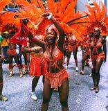 Atlanta Carnival Orange Crew. A group of women wearing orange feathered outfits with beads and headdress during a parade for Atlanta Caribbean Carnival 2014 Royalty Free Stock Photos