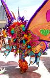 Atlanta Carnival Rainbow Butterfly Woman. A woman wearing a multi-colored outfit with huge butterfly wings during a parade for Atlanta Caribbean Carnival 2014 royalty free stock photography