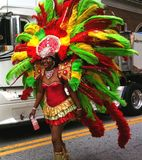 Atlanta Carnival Red and Green Headdress 2. A woman wearing a multi-colored outfit with matching headdress during a parade for Atlanta Caribbean Carnival 2014 Stock Image