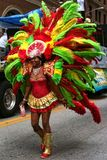 Atlanta Carnival Red and Green Headdress 1. A woman wearing a multi-colored outfit with matching headdress during a parade for Atlanta Caribbean Carnival 2014 Stock Photos