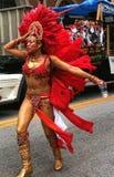 Atlanta Carnival Red Headress. A woman wearing a red feathered headdress during a parade for Atlanta Caribbean Carnival 2014 Stock Photos