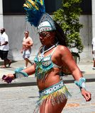 Atlanta Carnival White and Blue Bikini Girl. A woman wearing a white bikini outfit with blue feathers during a parade for Atlanta Caribbean Carnival 2014 Stock Photos