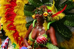 Atlanta Carnival Yellow and Green Headress. A woman wearing a multi-colored outfit with matching headdress during a parade for Atlanta Caribbean Carnival 2014 Royalty Free Stock Photos