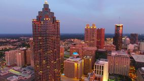 Atlanta cityscape aerial flying forward over downtown at dusk. Georgia USA stock footage