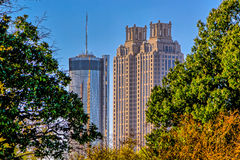 Atlanta cityscape buildings in between green trees Royalty Free Stock Photos