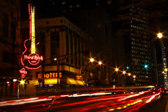 Atlanta Downt Hard Rock Cafe and Hooters at Night. A shot of traffic at night lends an extra sense of motion and energy as it passes the Hard Rock Cafe and stock photography