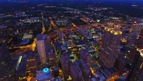 Atlanta downtown lights at dusk. Camera hovering in the air above city center. Real time. Static view. Freeway headlights stock footage