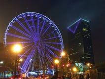 Atlanta Ferris Wheel Purple. Image of a giant ferris wheel at night located next to Centennial Olympic Park in downtown Atlanta, Georgia. Showing purple neon stock image