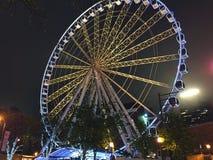 Atlanta Ferris Wheel White. Image of a giant ferris wheel at night located next to Centennial Olympic Park in downtown Atlanta, Georgia Royalty Free Stock Photo