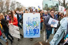 Anti Gun Protesters Walk At Atlanta March For Our Lives. Atlanta, GA, USA - March 24, 2018:  Protesters holding signs walk among thousands at the Atlanta March Stock Photography
