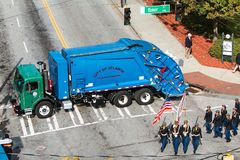Garbage Truck Blocks Street To Prevent Terrorism During Veterans Parade Stock Photos