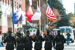 Color Guard Presents Colors While Walking In Atlanta Veterans Parade. Atlanta, GA, USA - November 11, 2017:  A color guard of six uniformed men presents the Stock Photos