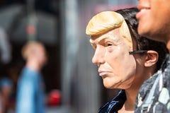 Person Wears Donald Trump Mask At Atlanta Halloween Parade. Atlanta, GA, USA - October 21, 2017:  A person wears a Donald Trump mask at the Little Five Points Royalty Free Stock Photography
