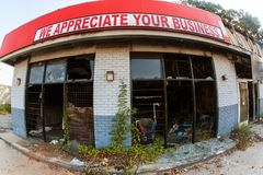 Ironic Sign Sits Above Burned Out And Vandalized Small Business. Atlanta, GA, USA - September 23, 2017:  Fisheye view of a sign reading `We appreciate your Royalty Free Stock Photos
