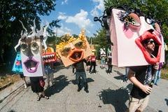 People Wearing Huge Handmade Masks Walk In Atlanta Festival Parade. Atlanta, GA, USA - September 23, 2017:  People wearing huge handmade custom masks walk in the Royalty Free Stock Images