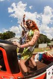 Men In Drag Wave To Parade Crowd At Atlanta Festival. Atlanta, GA, USA - September 23, 2017:  Two men in drag stand in the back of a pickup truck and proudly Stock Photos