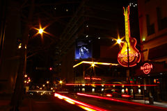 Atlanta - Hard Rock Cafe with Copy Space. A shot of traffic at night lends an extra sense of motion and energy as it passes the Hard Rock Cafe in downtown stock photography