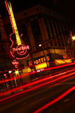 Atlanta - Hard Rock Cafe and Hooters at Night. A shot of traffic at night lends an extra sense of motion and energy as it passes the Hard Rock Cafe and Hooters royalty free stock image