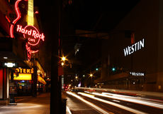 Atlanta - Hard Rock, Hooters and the Westin Hotel. A shot of traffic at night lends an extra sense of motion and energy as it passes the Hard Rock Cafe, Hooters royalty free stock photography