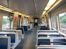 Atlanta Marta New Train Interior. Interior of an empty Marta train in Atlanta. The blue seats and the LCD TVs by the door indicate that it's a new train car Stock Image