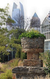 Atlanta Old and New. A 19th century garden planter with the modern Midtown Atlanta skyline in the background.  Focus on the planter Royalty Free Stock Photo