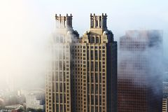 Atlanta& x27;s south end buildings in fog stock photos