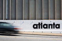 Atlanta street scene. A car travels west on 10th street in the West Midtown Arts District of Atlanta Stock Photos