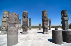 Atlantean figures and ancient pillars against blue sky at the arc Stock Image