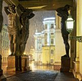 Atlantes of the Hermitage and rain in St. Petersburg. Night panorama of the sculptures of Atlantes of the Hermitage and rain in St. Petersburg Royalty Free Stock Image