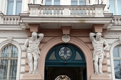 Atlantes supporting the balcony of a building in Prague. Stock Photos