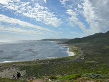 Atlantic òcean and long white cloud sky in South Africa Stock Images