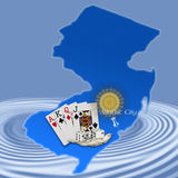 Atlantic City,New Jersey(Map). Atlantic City Map with cards,dice,seashell and sun depicting Atlantic City on blue background with ripples Stock Photo