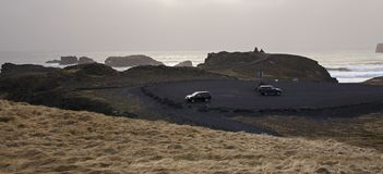 The Atlantic coast with black sand and huge lava rocks stock photography