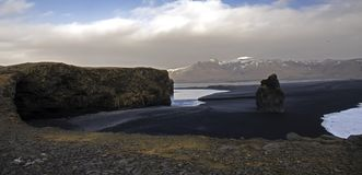 The Atlantic coast with black sand and huge lava rocks stock images